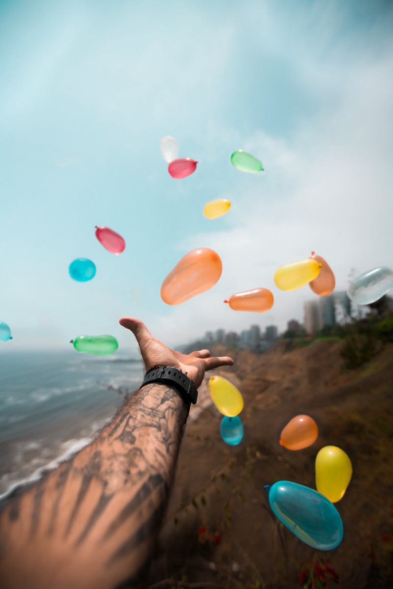 Happiness does not make you happy - Happy Mindset - balloons released in the air